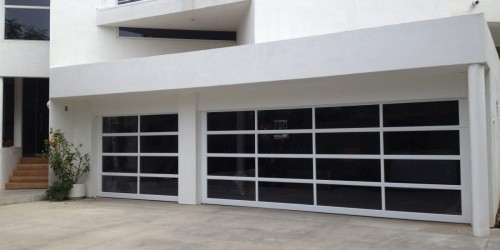 To hire an efficient glass garage doors specialist in San Diego at the lowest price, contact Castle Improvements. The prominent garage door repairing and installation agency has trained experts to provide hassle-free turnkey service for glass garage doors of any size.  https://castlegaragedoors.com/project/avante-garage-doors/  #glassgaragedoors #stylishglassgaragedoor #garagedoor